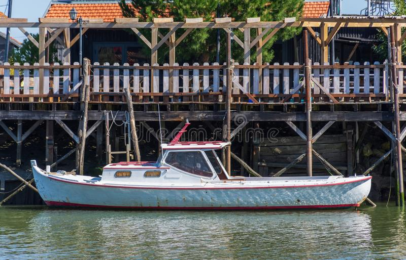 Arcachon Bay, France. The oyster port of Gujan Mestras. Traditional boat called Pinasse in the oyster port of Gujan Mestras, close to Arcachon, France stock photography