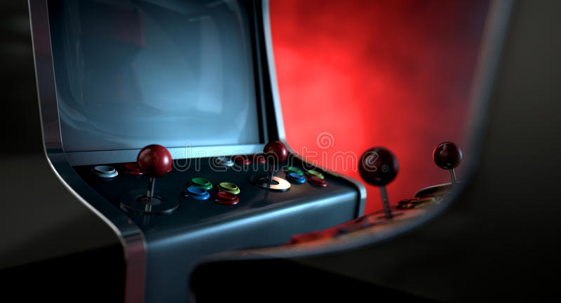 Arcade Machine Opposing Duel. Two vintage unbranded arcade games with a joysticks and buttons and a blank screen opposing each other lit by contrasting colour royalty free stock photo