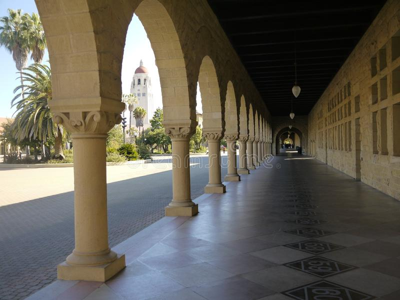 Stanford University: arcade of arches with tower view stock photography