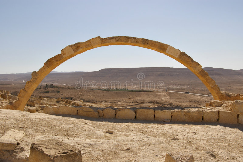 Arch in an ancient desert city Israel. Details of a stone arch in an ancient Nabataean desert city Israel royalty free stock photos