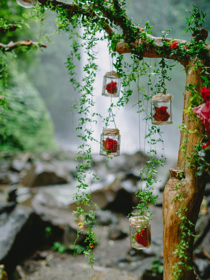 Arch with beautiful flowers and decorations. Wedding ceremony at waterfall. Arch with beautiful flowers and decorations. Wedding ceremony stock image