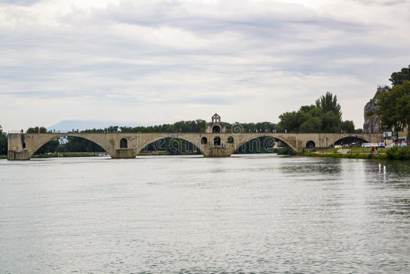 Arch bridge in Avignon, France on the Little Rhone. Famous arch bridge in Avignon in southern France on the Little Rhone, a UNESCO World Heritage Site stock photo