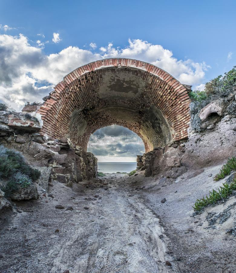 Arch of Capo Altano. The Capo Altano arch was built by the Italian army in the Second World War, a particular site of the Sulcis in Sardinia, Italy stock images