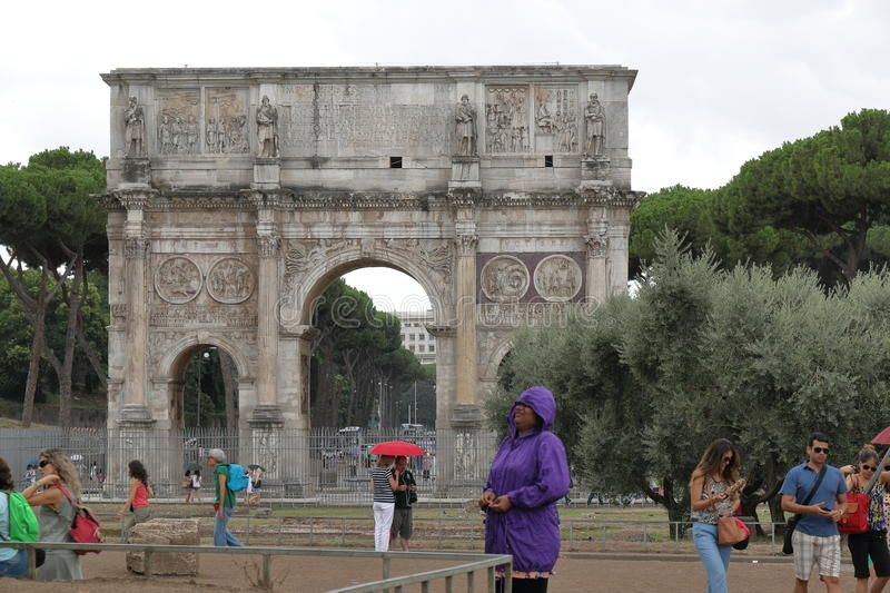 Arch of Constantine (Arco di Constantino) in rainy weather. Rome. Rome, Italy - August 16, 2015: View on Arch of Constantine (Arco di Constantino) in rainy stock image