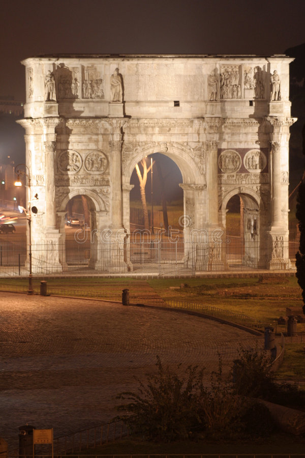 Arch of Constantine Night (Rome - Italy - Europe). Arch of Constantine (Rome - Italy - Europe) - Triumphal arch in Rome, situated between the Colosseum and the stock images