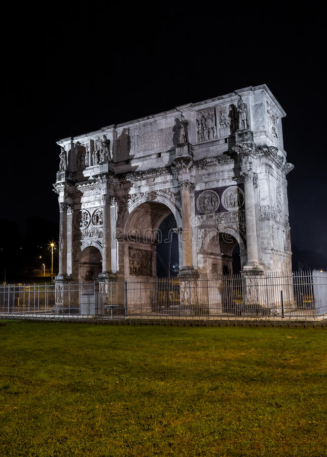 Arch of Constantine at night stock photo