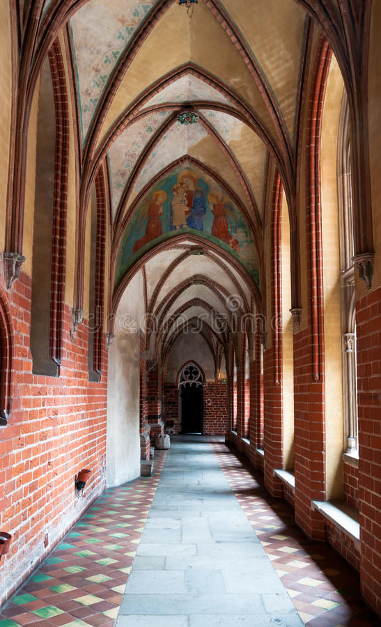 Arch corridor in Malbork castle. Narrow corridor of the Teutonic castle Malbork in Pomerania region of Poland. UNESCO World Heritage Site. Knights fortress also stock photography