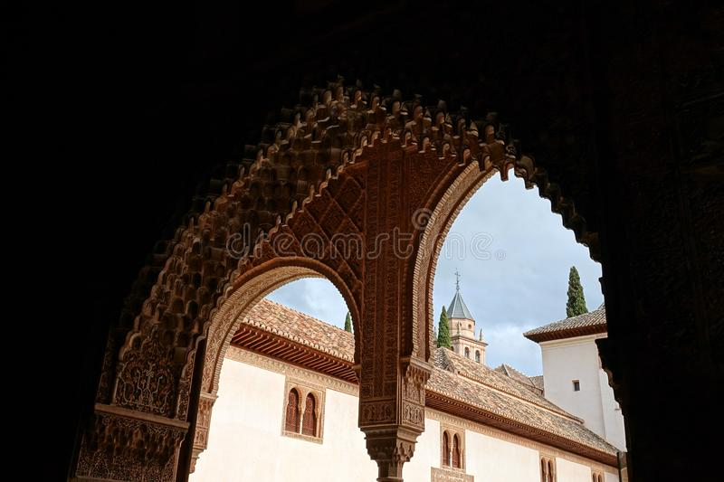 Arch at the Hall of the Ambassadors at Nasrid palace of the Alhambra in Granada, Andalusia. Arch decorations with arabesque ornaments at the Salon de Embajadores stock photo