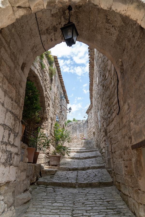 Arch door entrance in Lacoste small typical village in Provence France stock image