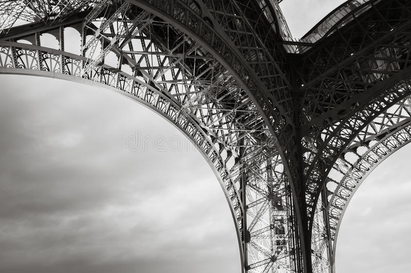 Arch of the Eiffel tower bearings. The most popular landmark of Paris, France. Monochrome photo with retro style effect royalty free stock photo