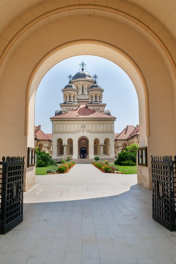 Coronation Orthodox Cathedral inside Fortress of Alba Iulia, Transylvania, Romania. Arch framede entrance of Coronation Orthodox Cathedral inside Fortress of royalty free stock image