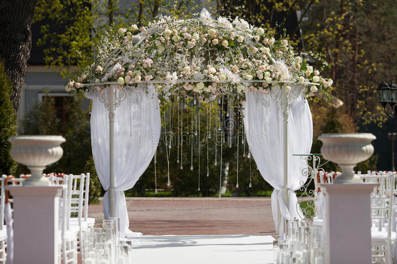 Arch in the garden for wedding ceremony stock photography