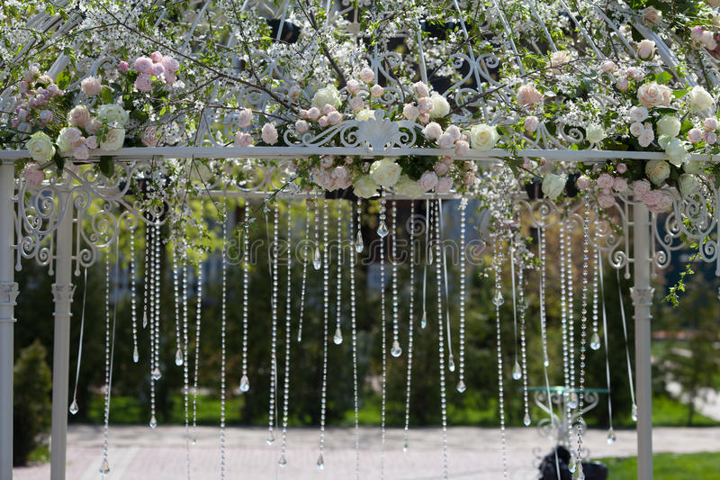 Arch in the garden for wedding ceremony stock photo