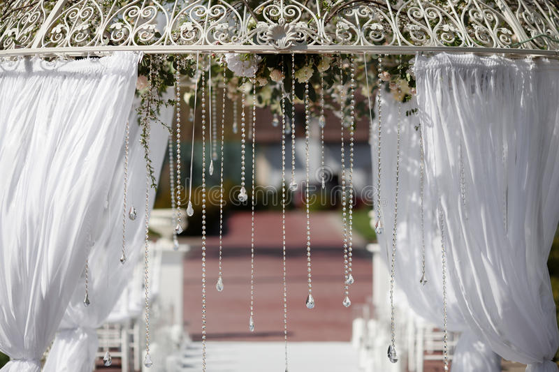 Arch in the garden for wedding ceremony stock photos