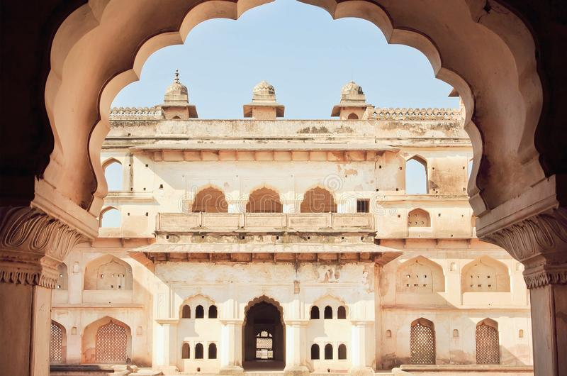 Arch in indian palace. Example of classical architecture of India. Towers of historical structure, walls and balconies. Built in old times royalty free stock images
