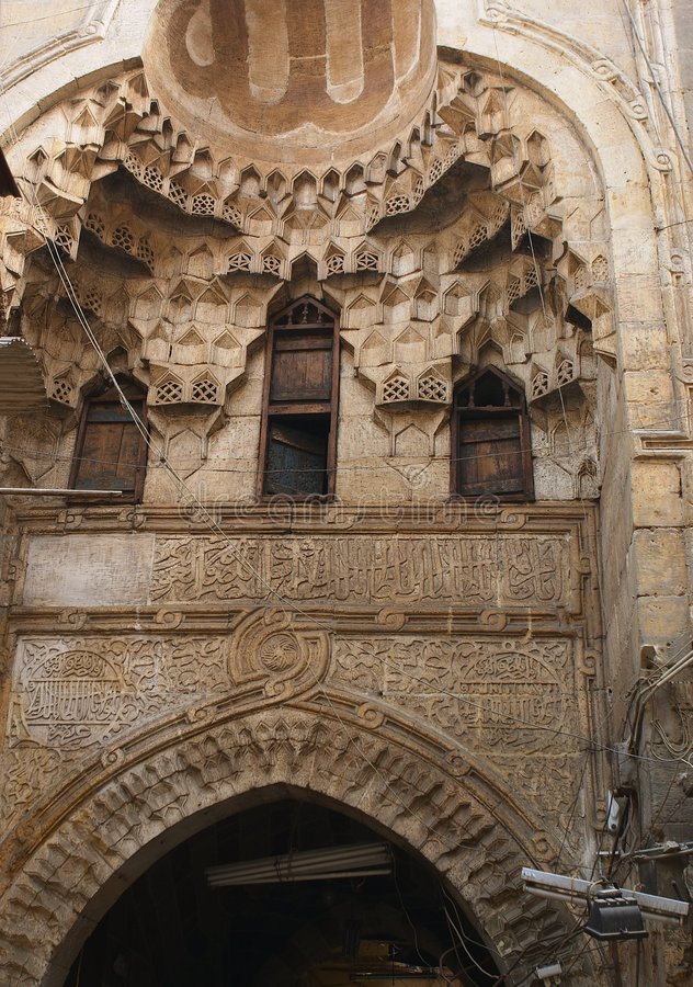 Arch, Khan el-Kalil bazaar. Ancient arch with windows, probably for the harem women,in the 700-year-old Khan el Khalili bazaar, Cairo stock image