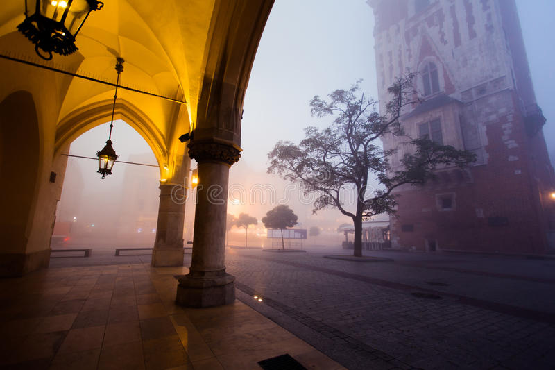 Arch on the market square in Krakow at morning fog. Poland royalty free stock photos