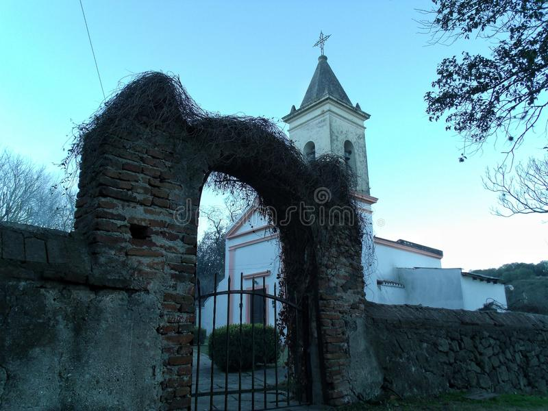 Arch and old church in the countryside stock photo