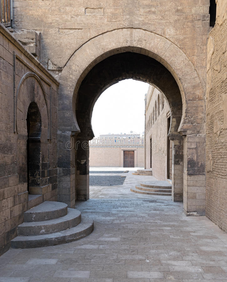 Arch at one of the passages surrounding Ibn Tulun Mosque royalty free stock image