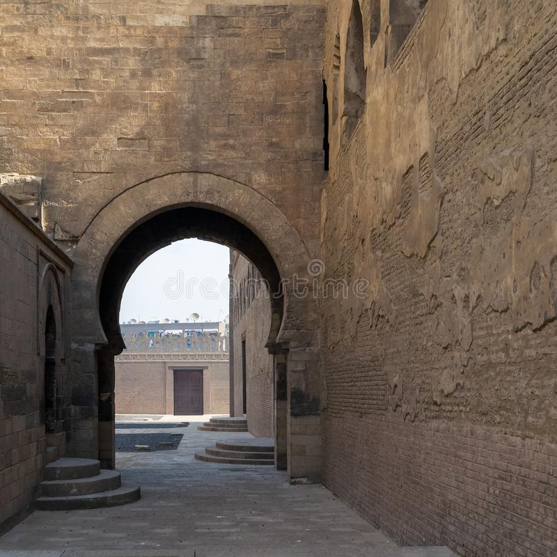 Arch at one of the passages surrounding Ibn Tulun Mosque, Medieval Cairo, Egypt. Arch at one of the passages surrounding Ibn Tulun Mosque, Sayyida Zaynab stock photos