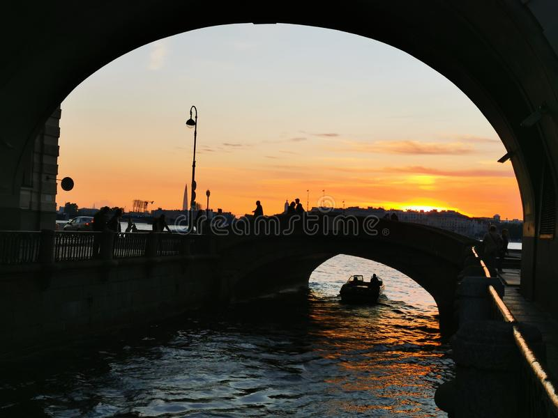 Arch over the Winter canal. white nights. Saint-Petersburg, Russia royalty free stock photography