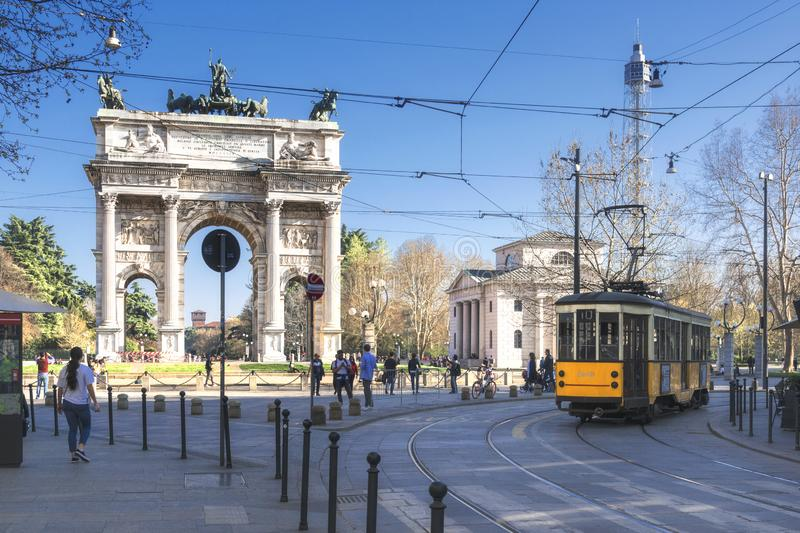 Arch of Peace Arco della Pace with traditional yellow tram in Milano, Italy. royalty free stock photos
