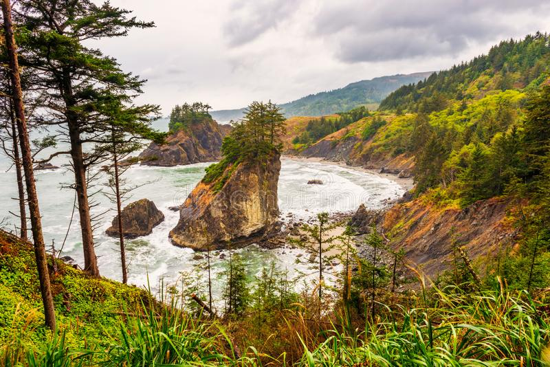 Arch Rock in Brookings Oregon. Arch Rock in Brookings, Oregon, USA on a wet and overcast summer day in September stock image