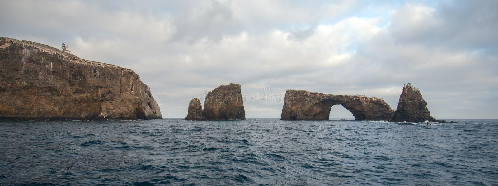 Arch Rock and Lighthouse of Anacapa Island of the Channel Islands National Park off the gold coast of California United States.  stock photo