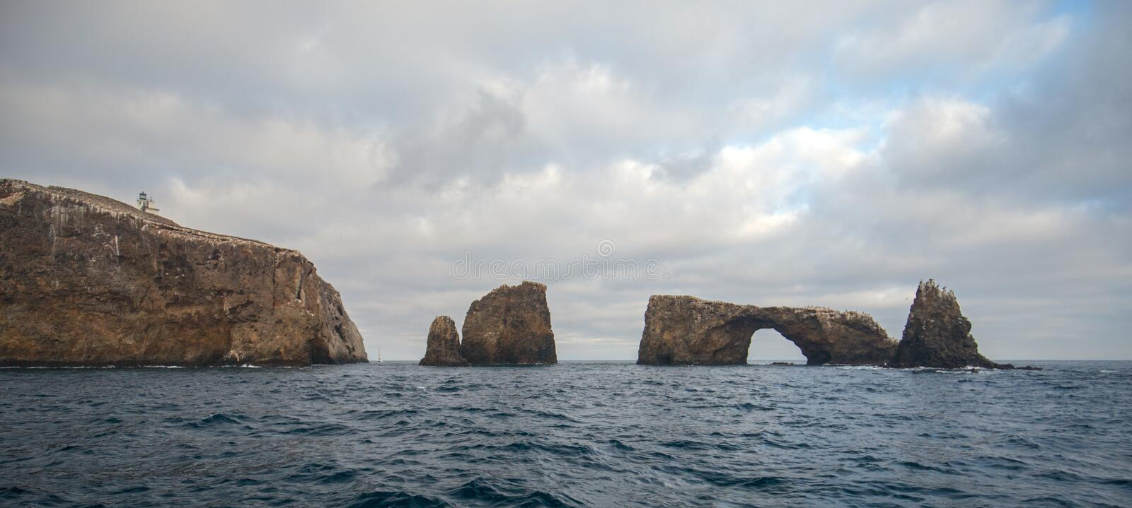 Arch Rock and Lighthouse of Anacapa Island of the Channel Islands National Park off the gold coast of California United States.  royalty free stock image