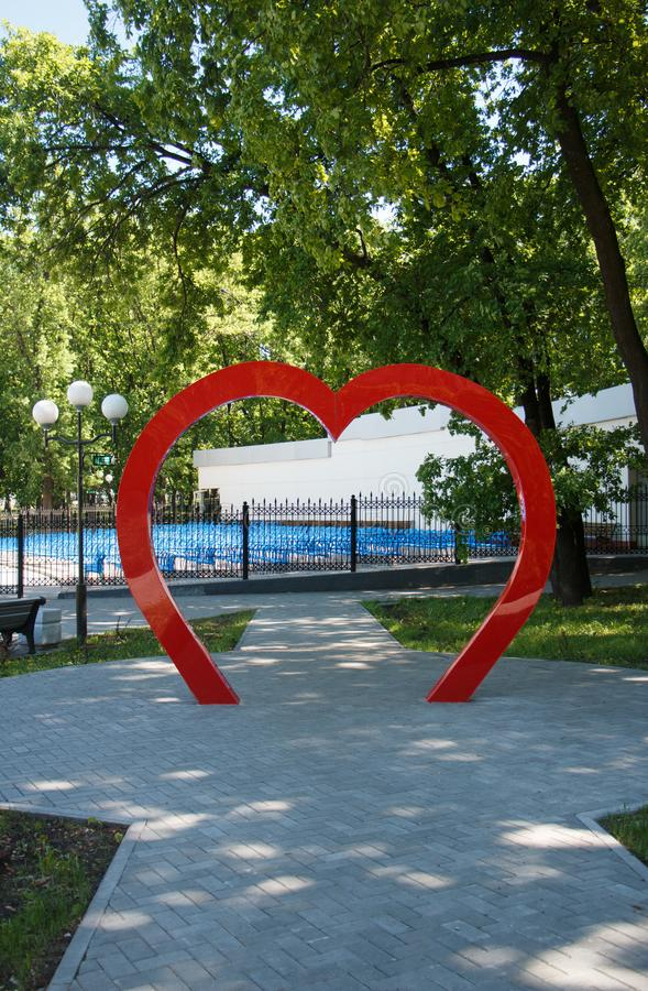 Arch romantic in the form of a heart in the Park of lovers royalty free stock photo