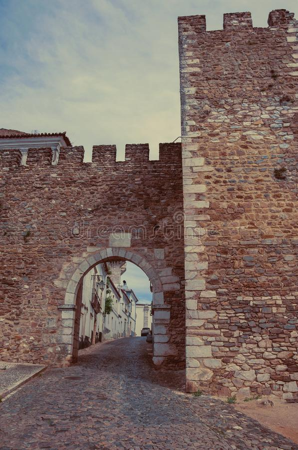 Arch of Santarem, a gateway at the Castle of Estremoz. Arch of Santarem in a cloudy day, a gateway in the stone outer wall at the Castle of Estremoz. A nice stock photography
