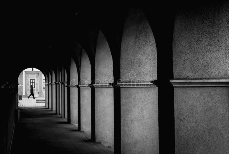 Arch schadow minimal person. In the end of corridor royalty free stock photo
