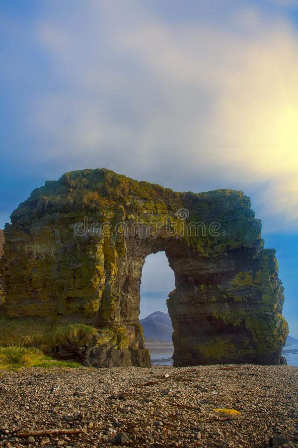 Arch of Steller. Massive stone arch. Arch of Steller (in honor of zoologist Georg Steller). Massive stone arch on shore of Pacific ocean. Bering Island stock image