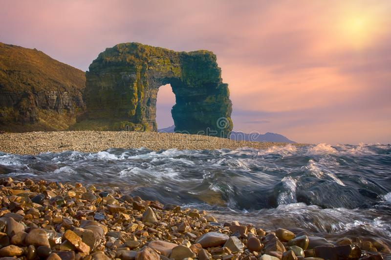 Arch of Steller. Massive stone arch. Arch of Steller (in honor of zoologist Georg Steller). Massive stone arch on shore of Pacific ocean. Bering Island royalty free stock photography