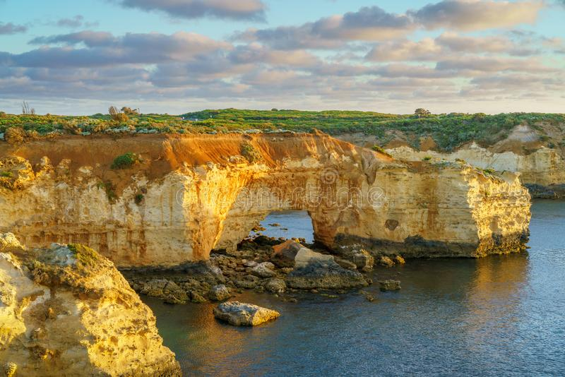 Arch at sunset at bay of islands, great ocean road, victory, australia 1 royalty free stock image