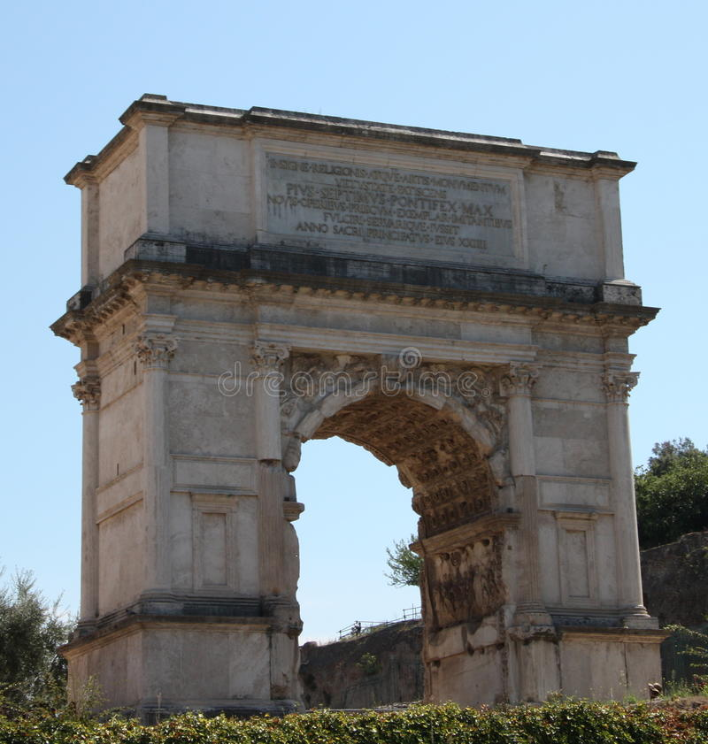 Arch of Titus in Rome. The Arch of Titus is a 1st-century honorific arch located on the Via Sacra, Rome, Italy, just to the south-east of the Roman Forum. It was stock photo