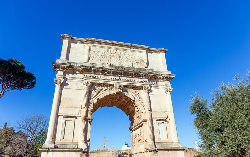 The Arch of Titus on the Via Sacra, Rome, Italy. The Arch of Titus is a 1st-century AD honorific arch, located on the Via Sacra, Rome, just to the south-east of royalty free stock photo