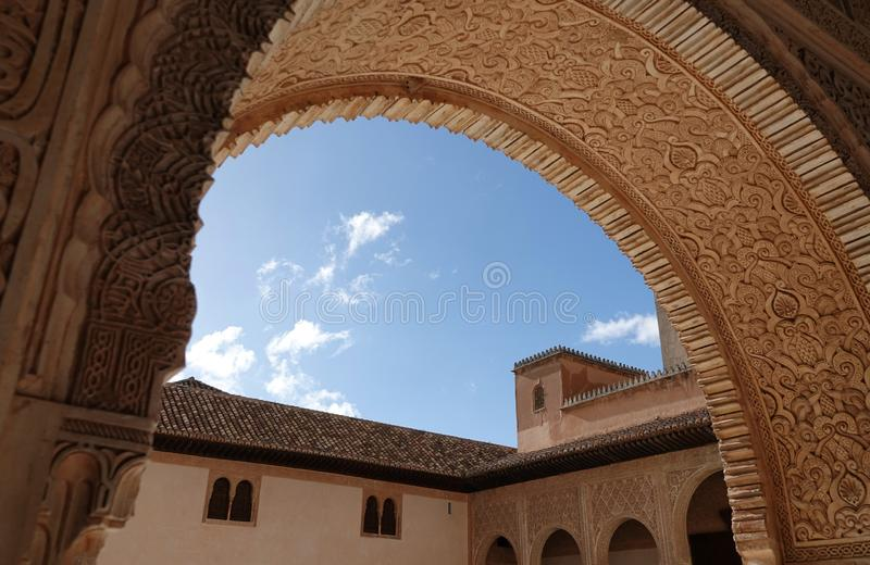 Arch to Palacio de Comares at Nasrid palace of the Alhambra in Granada, Andalusia. Wall decorations with arabesque ornaments at the Palacio De Comares at the royalty free stock photography