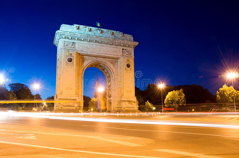 Arch Of Triumph by night. Arcul de Triumf is a triumphal arch located in the northern part of Bucharest, on the Kiseleff Road royalty free stock image