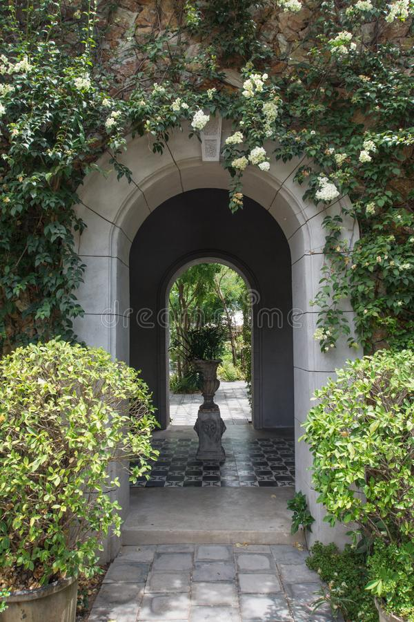 Arch tunnel in the garden royalty free stock photography