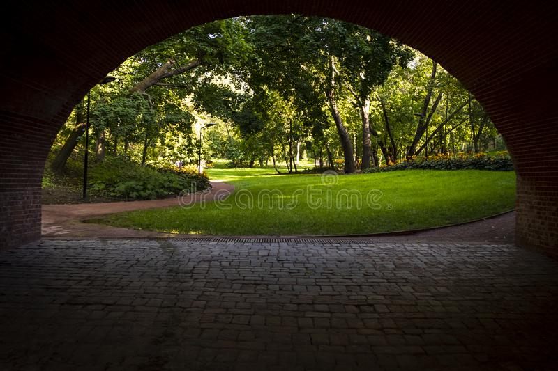 Arch under the bridge to the park.  royalty free stock photo