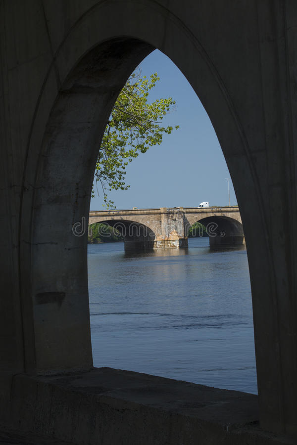 Arch under the Founders Bridge at Hartford, Connecticut. View of Bulkeley Bridge seen through an arch of the Founders Bridge on the Connecticut River in royalty free stock images