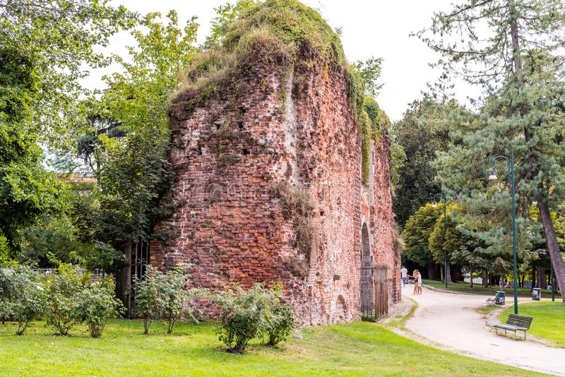 Arch and wall ruins  in Sempione Park, a large city park in Milan next to the Sforza Castle Castello Sforzesco, built in the royalty free stock images