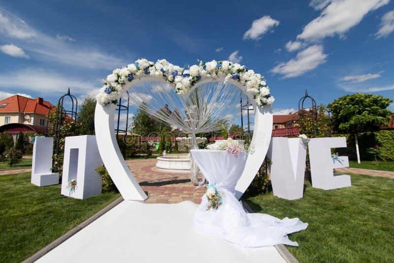 Arch at wedding ceremony stock photos