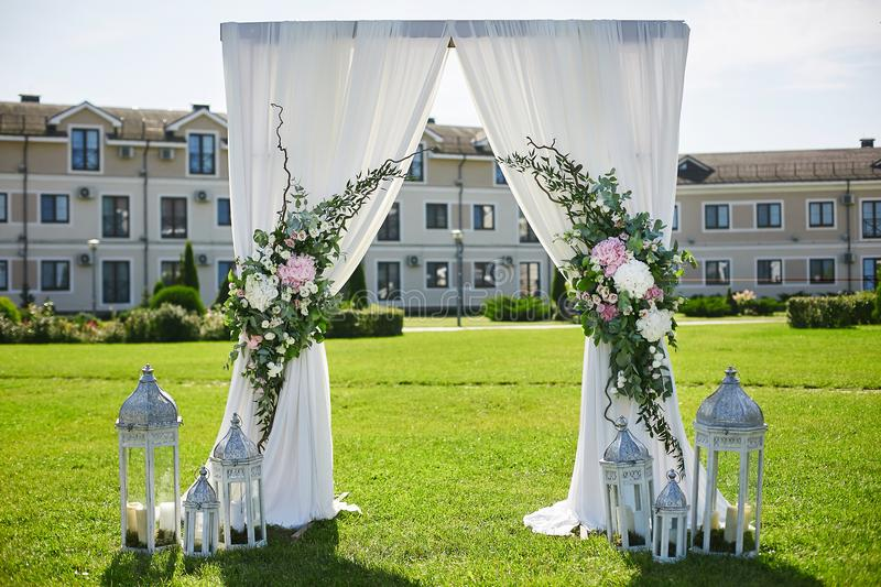 Arch for wedding ceremony with white curtain and fresh flowers download arch for wedding ceremony with white curtain and fresh flowers wedding decoration stock image junglespirit Images