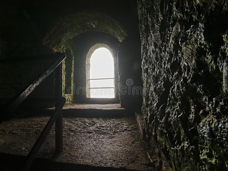 Arch window in old fortified Hell Fire club hunting logs stock image
