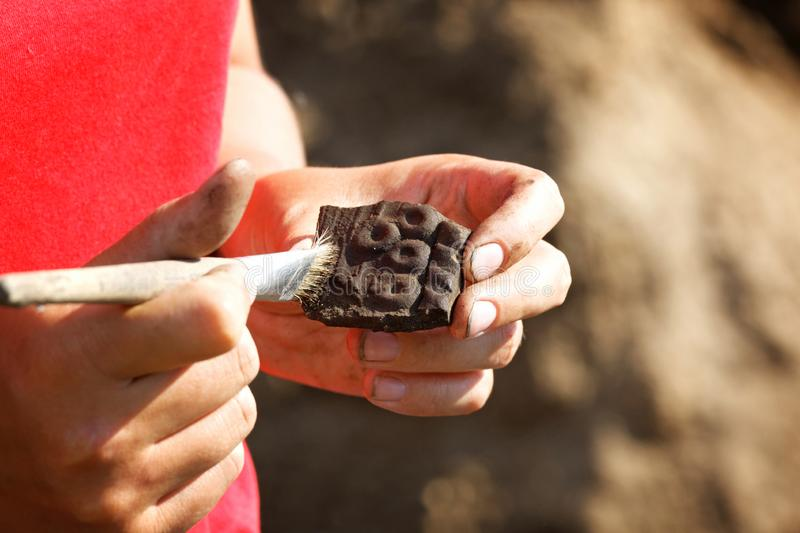 Archaeological find-part of a medieval broken clay vessel stock photo