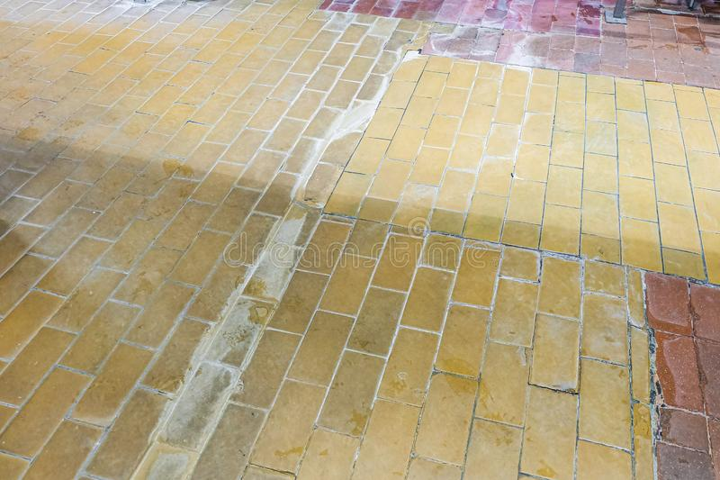 Archaic old tiled floor at an industrial plant.  stock images