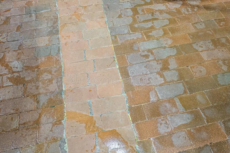 Archaic old tiled floor at an industrial plant.  royalty free stock image