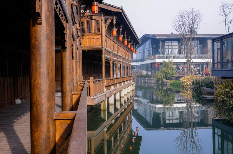 Archaised gallery near water,Chengdu,China. An archaized wooden gallery at the riverside in foggy winter morning,at Chengdu,China stock photos